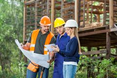 Architects Using Digital Tablet At Construction royalty free stock photos