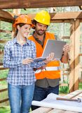 Architects Using Laptop Together At Construction Royalty Free Stock Photography