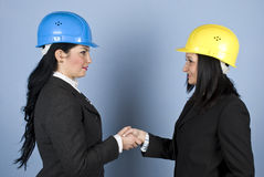 Architects women shaking hands stock image