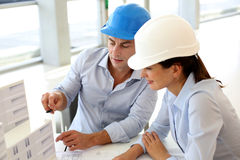 Architects at work. Architects working on project in office Royalty Free Stock Photography