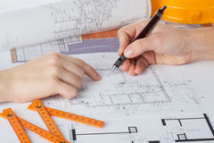 Architects at work. Architect's hands work with a blueprints, closeup royalty free stock images