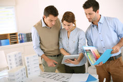 Architects at work. Team of architects working in office Royalty Free Stock Photos