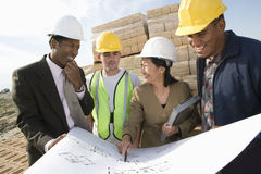Architects And Workers Discussing At Site Stock Photos