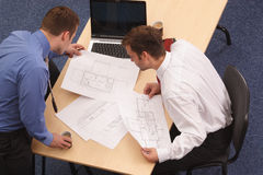 Architects working. Two architects working on blueprints Royalty Free Stock Photography