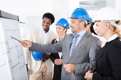 Architects working on blueprint Royalty Free Stock Photo