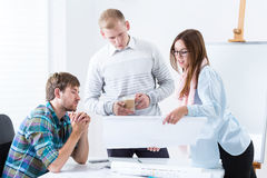 Architects working on blueprint Stock Images