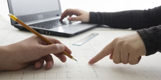 Architects working on blueprint, real estate project. Architect workplace - architectural project, blueprints, ruler. Architects working on blueprint. Architects Royalty Free Stock Image