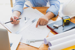 Architects working with blueprints Stock Photo