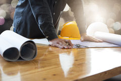 Architects working with blueprints in the office Stock Images