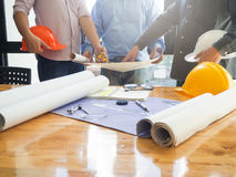 Architects working with blueprints in the office Royalty Free Stock Photography