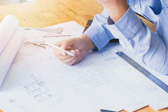 Architects working with blueprints in the office Stock Image