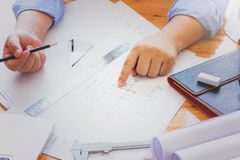 Architects working with blueprints in the office. Royalty Free Stock Photos