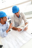 Architects working on construction plan Stock Images