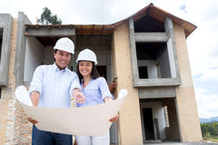 Architects working on a house project Royalty Free Stock Photo
