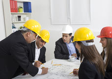 Architects working in office on Stock Images