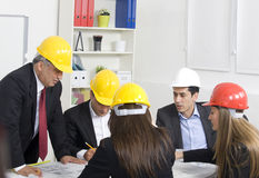 Architects working in office on Stock Photo