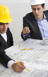 Architects working in office Stock Photography