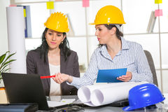 Architects working in office on construction project. Royalty Free Stock Photo