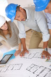 Architects working in office with entrepreneur Stock Image