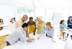 Architects Working on a Plan.  Royalty Free Stock Photography