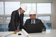 Architects working on planning Stock Images
