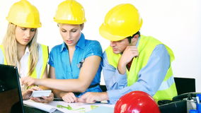 Architects working with plans in office stock footage