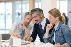 Architects working on project. Team of architects working on construction project Royalty Free Stock Image