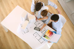 Architects working on project. Upper view of architects working in office Royalty Free Stock Images