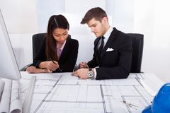 Architects working together on blueprint Royalty Free Stock Photography