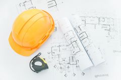Architectural blueprints with measuring tape, safety helmet and tools on table. top view. Architects workplace - architectural blueprints with measuring tape royalty free stock images