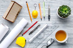 Architects workplace with tools on light wooden background top view Stock Images