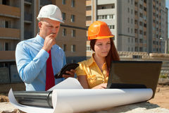 Architects works in front of building site Stock Images