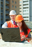 Architects  works in front of building site Stock Photography