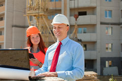 Architects  works in front of building site Royalty Free Stock Photo