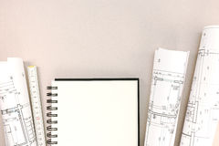 Architects workspace with blueprints, notepad and folding rule Royalty Free Stock Photos
