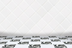 Architectual background made of white diamond mosaic and black and white floor. Wall made of little modern beige diamond ceramic mosaic and floor made of mosaic Royalty Free Stock Images