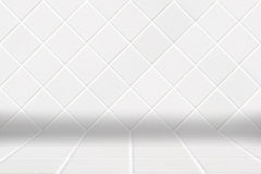 Architectual background made of white diamond mosaic and white floor. Wall made of little modern beige diamond ceramic mosaic and floor made of white squares Stock Image