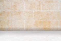 Architectual background made of white mosaic and orange irregular facade Stock Image