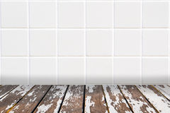 Architectual background made of white mosaic and uncared wooden laths. Wall made of little modern beige ceramic mosaic and floor made of uncared wooden laths Stock Images