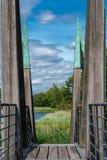 Architectual striking wooden pedestrian bridge with wild nature royalty free stock photography