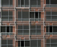 Architectural Abstract. The side of a building which has been covered in overlapping screens. I thought it made an interesting geometric pattern, and could be Stock Images