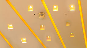 Architectural abstract ceiling light fixtures. Beautiful abstract shapes of the light fixtures of a modern building ceiling Royalty Free Stock Photography