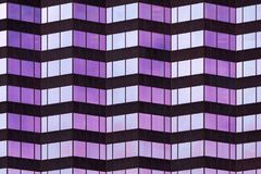 Tampa architectural abstract. Architectural geometric abstract of wavy lines with purple and blue glass windows stock photo