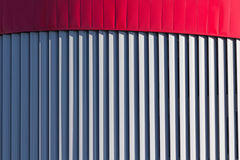 Architectural abstraction in the form of vertical stripes. Backgrounds and textures royalty free stock image