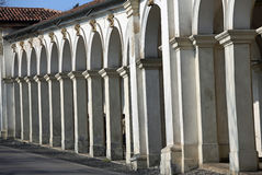 Architectural arcades on the uphill road leading at Basilica ded. Long line of Wonderful architectural arcades on the uphill road leading at Basilica dedicated Stock Images