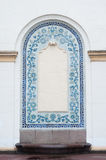 Architectural arch on facade of building with blue stucco Royalty Free Stock Photo