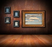 Architectural backdrop with frames on grunge wall Stock Image