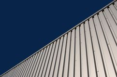 Architectural background. Facade made of corrugated metal against blue sky Royalty Free Stock Photos