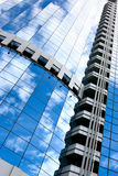 Architectural background. With building and sky reflction in the windows royalty free stock photo