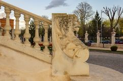 Architectural background of a balustrade topped by the effigy of a lion. royalty free stock image